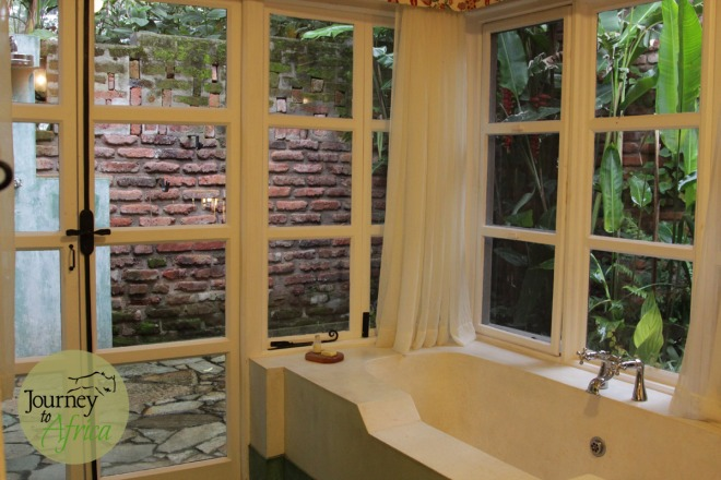 The bathroom with 3 options on how to clean after a Safari. Indoor shower, outdoor shower or tub. Choices!